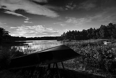 Rowing Boat on Shore of Archipelago (www.davidrosenphotography.com) Tags: boat sweden blackwhite water clouds archipelago reflections