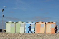 Never the same (marktmcn) Tags: beach huts seaford east sussex coast seaside england shingle colours passers by striding promenade sky dsc rx100 esplanade