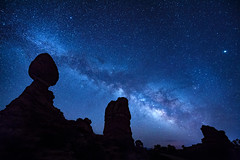 The Milky Way over Balanced Rock sandstone rock formation with the bright star Sirius on the right at Arches National Park, Moab, Utah (diana_robinson) Tags: milkyway nightphotography nightsky dark night stars heavens galaxy bandoflight balancedrock sandstonerockformation archesnationalpark moab utah starsirius whitedwarfstar