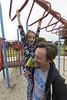 Shes Cheating (evaxebra) Tags: luna park playground play monkey bars ryan help cheat binoculars carry