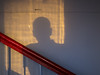 The shadow of a man from the sunset on the wall of the staircase whith handrail (Vitaliy V.) Tags: people shadow man person handrail evening old glass texture staircase banister skin bonehead bright light railing silhouette stairs wall anonymous mystery stairwell anonymity dark enclosed head indoors male moody mysterious one outline photo photograph rail single stairway sun touching two unrecognizable building grid walk abstract architecturaldetail architecture backdrop background banisterrail