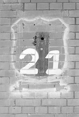 Former glory (onemanifest) Tags: sign door gone past history 21 bricks wall number paint film analog monochrome blackwhite minoltaxd7 ilforddelta400