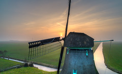 Dutch mill watching the sunset. (Alex-de-Haas) Tags: burgerbrug dji dutch fc6310 holland molenf nederland nederlands netherlands noordholland achtkantebinnenkruier aerial aerialphotography air boerenland cirrus drone fog grondzeiler landscape landschaft landschap lucht meadows mill mist molen oldmill polder poldermolen skies sky sundown sunset weilanden windmill windmolen winter zonsondergang nl