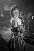 In Costume (The_Kevster) Tags: monochrome bw blackandwhite woman girl portrait person light shadows atmosphere dslr nikon d3300 london interior esethevooduupeople quadrafon videoshoot hernehill costume mask