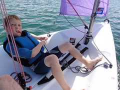 Sailing Boy (Carlton4211) Tags: summer holiday ireland rural happy kid boy young child sailing boat sail learn ropes wetsuit funny feet barefoot tongue fun pull exercise knot