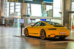Porsche 911 Carerra T (Elliot the Giraffe) Tags: osloairport norway porsche 911 yellow car empty fast minolta 50mm minolta50mmf17mcroccorxpf