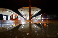 Wet reflections at Loughton Station (Luke Agbaimoni (last rounds)) Tags: london londonunderground londontube rain night tube train transportforlondon trains reflection reflections