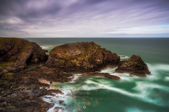 Weather Worn (Augmented Reality Images (Getty Contributor)) Tags: portknockie longexposure coastline landscape cave nisifilters cliffs water scotland waves morayfirth canon clouds seascape rocks unitedkingdom gb