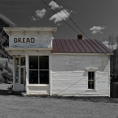 bread (Patinagal) Tags: building facade storefront mainstreet decay windows history relic victorian cornice