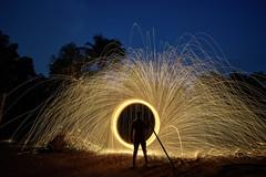 The Gatekeeper (Gulfu) Tags: steelwool photography kerala india gulfu sugulufactory long exposure digital art experiment fire spinning night blue sky travel shilloutte