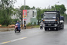 Never mind the rain (Roving I) Tags: trucks motorbikes weather rain roads rural countryside rainwear helmets tamky vietnam traffic