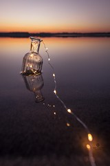 Little lights (Melanie Martinu) Tags: outdoor bottle sigmaart sigma canon germany bavaria lights colorful colors landscape reflection water sky nature lake sunset