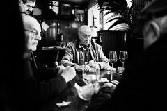 The decisive moment (Giulio Magnifico) Tags: decisive happy 28mm card citylife conversation udine friends fvg wine friuli happiness city deepsoul naturallight bw moment lights italy player soul blackandwhite candid leicaq ancient leica