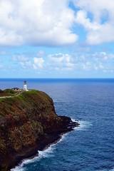 At the border (samytux) Tags: kīlaueapointlighthouse peninsula lighthouse sea landscape ocean pacificocean kauai hawaii coast grass water kilauea danielkinouye wildliferefuge clouds sky bluesky vacations faro phare paisaje belleza beautiful
