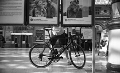Wheels (4foot2) Tags: streetphoto streetshot street streetphotography candid candidportrate reportagephotography reportage people peoplewatching interestingpeople pushbike bike wheel wheels station eastbourne analogue film filmphotography 35mmfilm 35mm 35mmf2 35mmf2summicron summicron leica leicam3 m3 mono monochrome bw blackandwhite rolleiretro rolleiretro400s rangefinder 4foot2 400s 4foot2flickr 4foot2photostream fourfoottwo 2018