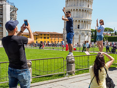 Snap 064 (Peter.Bartlett) Tags: bag women tourists people city olympuspenf woman urbanarte urban cellphone streetphotography hat man girl standing candid mobilephone m43 couple camera peterbartlett lunaphoto sign men colour fence pisa toscana italy it