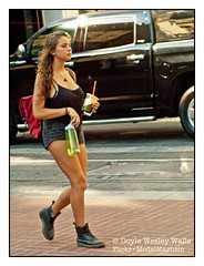 Gorgeous Pedestrian (Doyle Wesley Walls) Tags: 0213 woman girl female legs boots face hair pretty lovely sexy beauty beautiful pedestrian streetphotography busty shorts doylewesleywalls