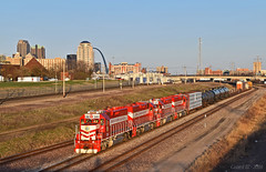 "Westbound Transfer in St. Louis, MO (""Righteous"" Grant G.) Tags: trra terminal railroad associaition st louis missouri emd power locomotive bnsf west westbound transfer freight yard job turn madison skyline"