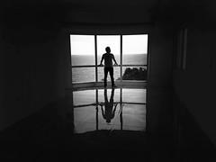 A room with a view (alestaleiro) Tags: silouhette bw bn pb mono monocromo monochrome me selfportrait autorretrato vista view ocean solitudine solidão soledad loneliness lonely alone man melancolia malinconia hombre homem silueta mar sight sightseein landscape pensativo reflexión reflejo reflection janela ventana window meditation solo solitario simetria symetri simetry simetric homme huomo male seul alma anima alestaleiro