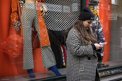 Checker Out (Silver Machine) Tags: london bricklane streetphotography street candid girl texting standing outdoor shopwindow beanie checkpattern fujifilm fujifilmxt10 fujinonxf35mmf2rwr