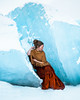 Ice Throne (Elizabeth Gadd) Tags: iceberg ice iceland woman girl red dress gold poncho shawl cloak beautiful portrait blue snow nature