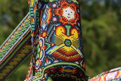 huichol bike detail (ikarusmedia) Tags: huichol bike detail closeup zoom trees beads chaquira art artcraft sculpture eagles drawings sun peyote patern reforma avenue mexico city
