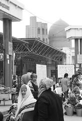 The Women Of The Samarkand Bazaar (peterkelly) Tags: bw digital canon 6d asia uzbekistan samarkand samarqand bazaar market women scarf dome bucket pillar column