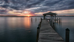 A distant fire. (Jill Bazeley) Tags: sunset sunrise dock piling pier jetty boat house boathouse bridge clouds dark damage hurricane intracoastal waterway florida indian river lagoon merritt island brevard county space coast sony a7rii nwn