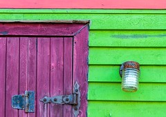 Purple Door (Karen_Chappell) Tags: purple green pink light lamp door building house rowhouse jellybeanrow stjohns newfoundland nfld city urban wood wooden paint painted hinge colourful multicoloured canada atlanticcanada avalonpeninsula downtown architecture detail geometry abstract geometric lines clapboard colours colour color