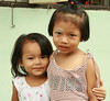 friends (the foreign photographer - ฝรั่งถ่) Tags: two girls toddler arm around khlong thanon portraits bangkhen bangkok thailand canon