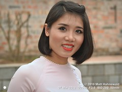 2018-03b Vietnam's Beauty (19) (Matt Hahnewald) Tags: matthahnewaldphotography facingtheworld real life aesthetic character head face makeup eyes catchlights falseeyelashes eyebrows beautifuleyes mouth teeth lips lipstick ear expression lookingcamera hair hairstyle consent emotion culture lifestyle enjoyment beauty style affection fondness goodtime equity impact sisterhood cultural photoshoot hanoi vietnam asia vietnamese asian oneperson female adult young woman photography image photo faceperception nikond3100 nikkorafs50mmf18g primelens 50mm 4x3 horizontal street portrait closeup threequarterview pink outdoor color posingforcamera hot smiling beautiful attractive pretty lovely headshot