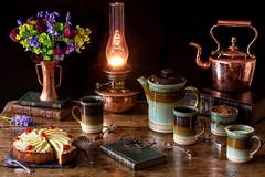 A Comfortable Afternoon... (memoryweaver) Tags: tabletop coffee homemade baking veritas lamp kerosene paraffin kerosenelamp paraffinlamp oillamp stilllife memoryweaver flowers vase bluebells tulips almond cake cherry