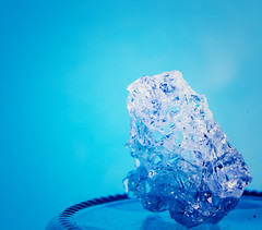 Shard (jimj0will) Tags: macromondays jagged brokenglass glass shard shattered blue negativespace jar natural light daylight outdoors tube extension canon tabletop minimalist fragment macro pyrex broken
