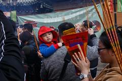Hong Kong (jaumescar) Tags: kowloon hongkong kid red celebration religion temple praying street photo crowd chinese people hand hood