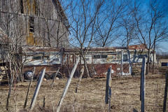 Old Trailer (gabi-h) Tags: trailer fence fencefriday gabih princeedwardcounty rural rustic rust barn architecture trees sky farm ontario old