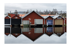 Boathouses (Housemill) Tags: boathouses huskvarna sweden reflection water vättern lx5 lumix panasonic pointandshoot pointshoot lowkey