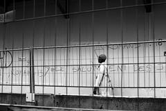 Along the wire netting (pascalcolin1) Tags: paris13 homme man grillage wirenetting lumière light photoderue streetview urbanarte noiretblanc blackandwhite photopascalcolin 50mm canon50mm canon