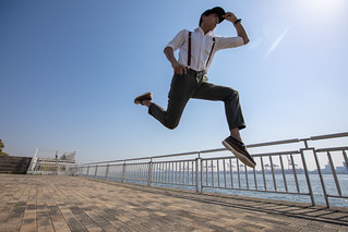 Young Asian guy jumping to the sky