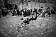 Flying dancer (jimiliop) Tags: dancer crowd people public show blackandwhite athens monastiraki street dancing acrobat motion flying performance man action