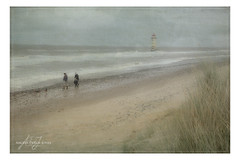 Walking on Talacre Beach (angeladj1) Tags: talacre lighthouse northwales beach sea maramgrass sand