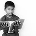 Indian School Boy Reading the Book