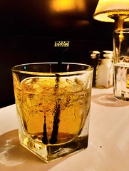 Whisky Glass and The Lamp (HSBasra) Tags: johnnie johnniewalker grill scotland walker alcohol drops glass refreshing cold inviting birthday restaurant light ambiance lamp black scotch whiskey whisky