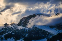 Winter was (Мaistora) Tags: mountains mountain hills rocks stone peak ridge snow winter sky clouds cloudy fog mist haze storm stormy light shadows glow turbulence drama dolomites corvara badia alps italy austria europe sony alpha ilce a6000 sell1650pz lightroom luminar nature outdoor outdoors landscape scenery skyscape explore explored14apr18