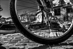 Sur les pavés..../ On the pavement... (vedebe) Tags: noiretblanc netb nb bw monochrome roue velo port ports barques mediterranée méditerranée mer bateaux bateau ville rue street city urbain urban rayons