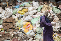 Pile (Photosightfaces) Tags: pile rubbish garbage trash bags carrying load man philippines bacong work recycling