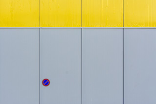 Sign on a grey and yellow wall