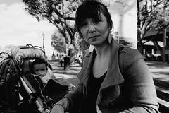 IMG_2700 (JetBlakInk) Tags: mono portrait pointofview face motherandbaby streetphotography women enigmaticsmile enigmatic woman mum