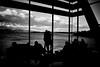 Room with a View (Harald Philipp) Tags: mona tasmania australia hobart lounge cafe water ocean bay sea window view clouds silhouette mountains nikon d810 nikkor monochrome blackandwhite bw schwarzweiss museum windows