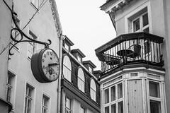 Old Tallinn (Markus Heinonen Photography) Tags: tallinn tallinna old town vanalinn city cityscape eesti estonia europe architecture clock kello parveke balkon mustavalkoinen blackwhite bw
