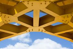 Yellow crane (Jan van der Wolf) Tags: map175414ve kraan hijskraan crane yellow geel nantes clouds wolken rivets symmetric symmetry symmetrie klinknagels iledenantes